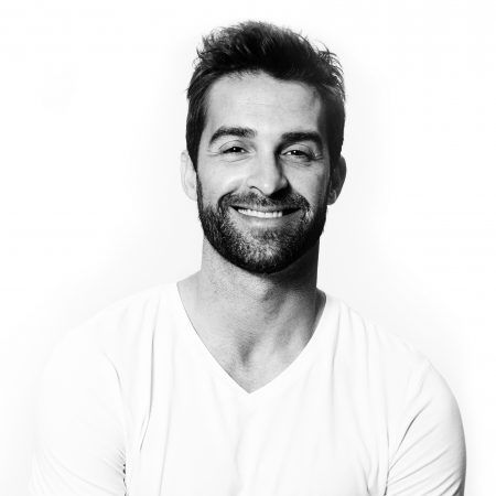 Smiling man in white t-shirt portrait studio